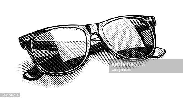 engraving illustration of retro style sunglasses cut out - pen and ink stock illustrations