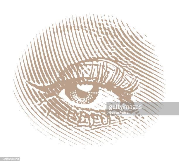 Engraving of a woman's eye