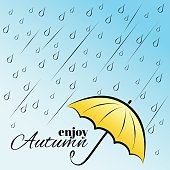 Enjoy autumn under umbrella
