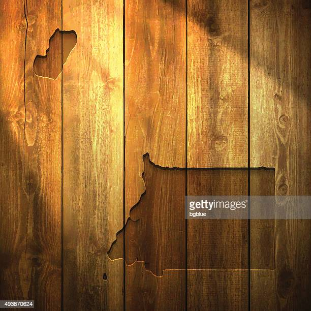 stockillustraties, clipart, cartoons en iconen met equatorial guinea map on lit wooden background - bloco
