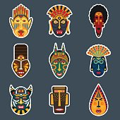 Ethnic ritual masks stickers set in flat style. Collection of african tribal mask icons.