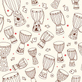 Ethnic seamless pattern with african drums djembe