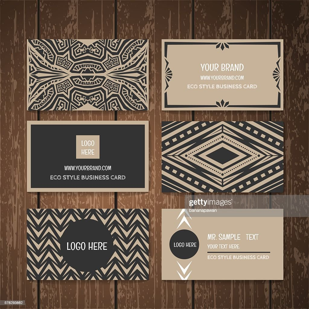 Ethnic tribal style business card collection on wood background.