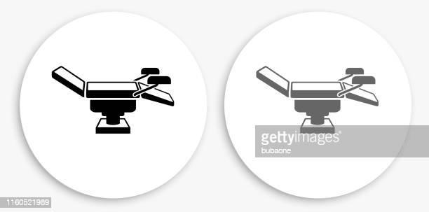 検査テーブル黒と白の丸いアイコン - 手術台点のイラスト素材/クリップアート素材/マンガ素材/アイコン素材