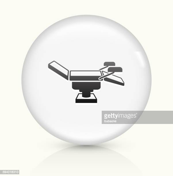 examination table icon on white round vector button - artificial insemination stock illustrations