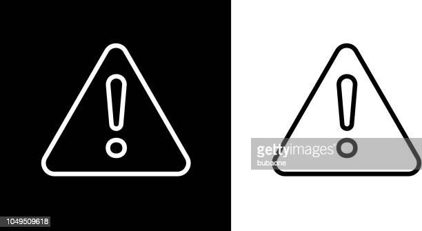 exclamation point triangular warning sign icon - exclamation mark stock illustrations