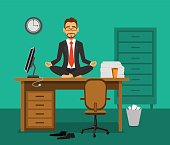 Exhausted employee meditating on a work desk in the office. Relaxation at workplace.