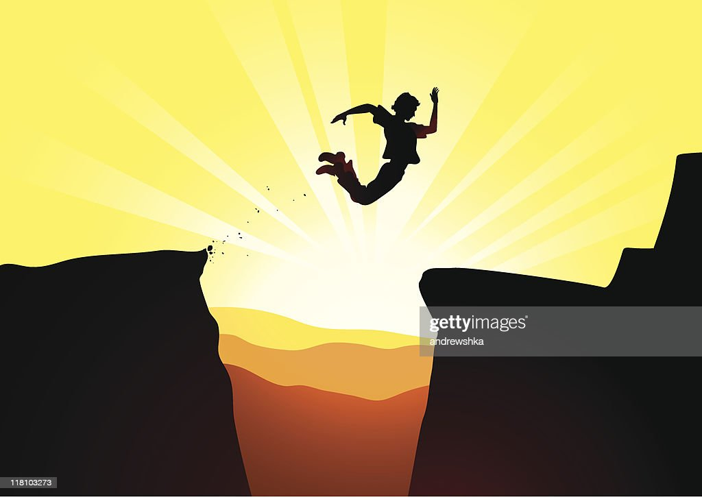 Extreme jump against a rising sun