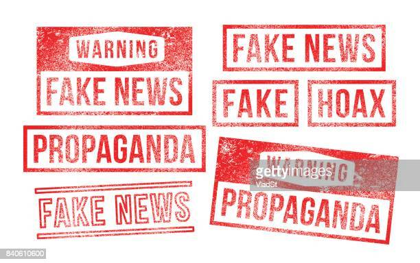 fake news propaganda hoax rubber stamps - artificial stock illustrations