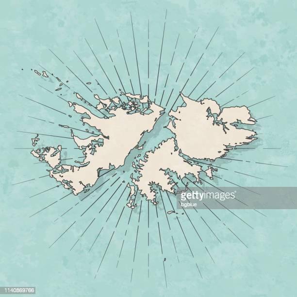 ilustraciones, imágenes clip art, dibujos animados e iconos de stock de islas malvinas mapa en estilo retro vintage-papel texturizado antiguo - islas malvinas