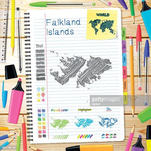 ilustraciones, imágenes clip art, dibujos animados e iconos de stock de islas malvinas mapa dibujado a mano sobre cuaderno. fondo de madera - islas malvinas