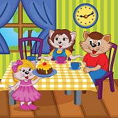 family cats eat cake together
