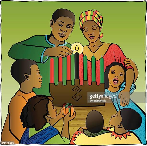 family celebrating kwanzaa - kwanzaa stock illustrations, clip art, cartoons, & icons