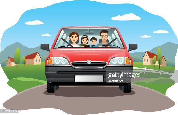 Family in a car on a country road