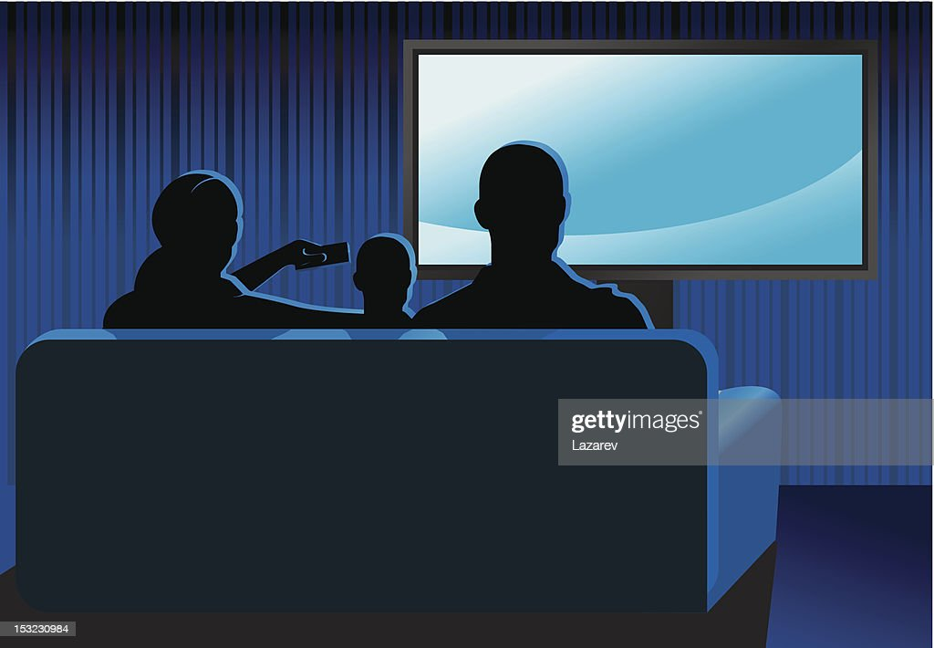 Family sitting together on couch watching TV