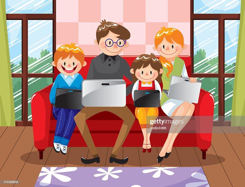 Family using laptop on sofa