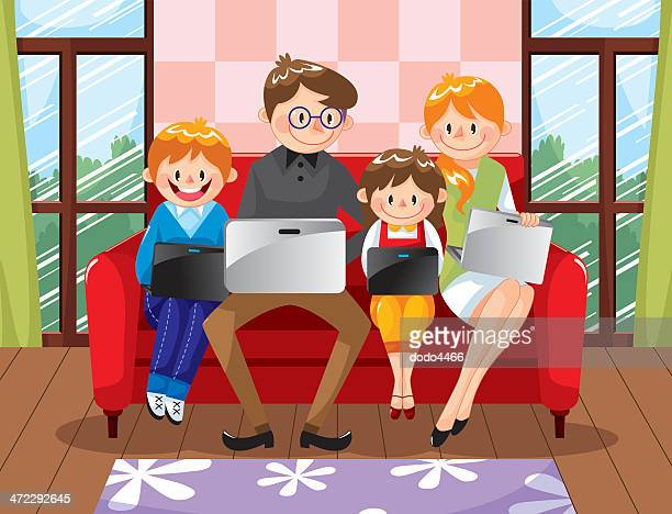 Family using laptop on sofa