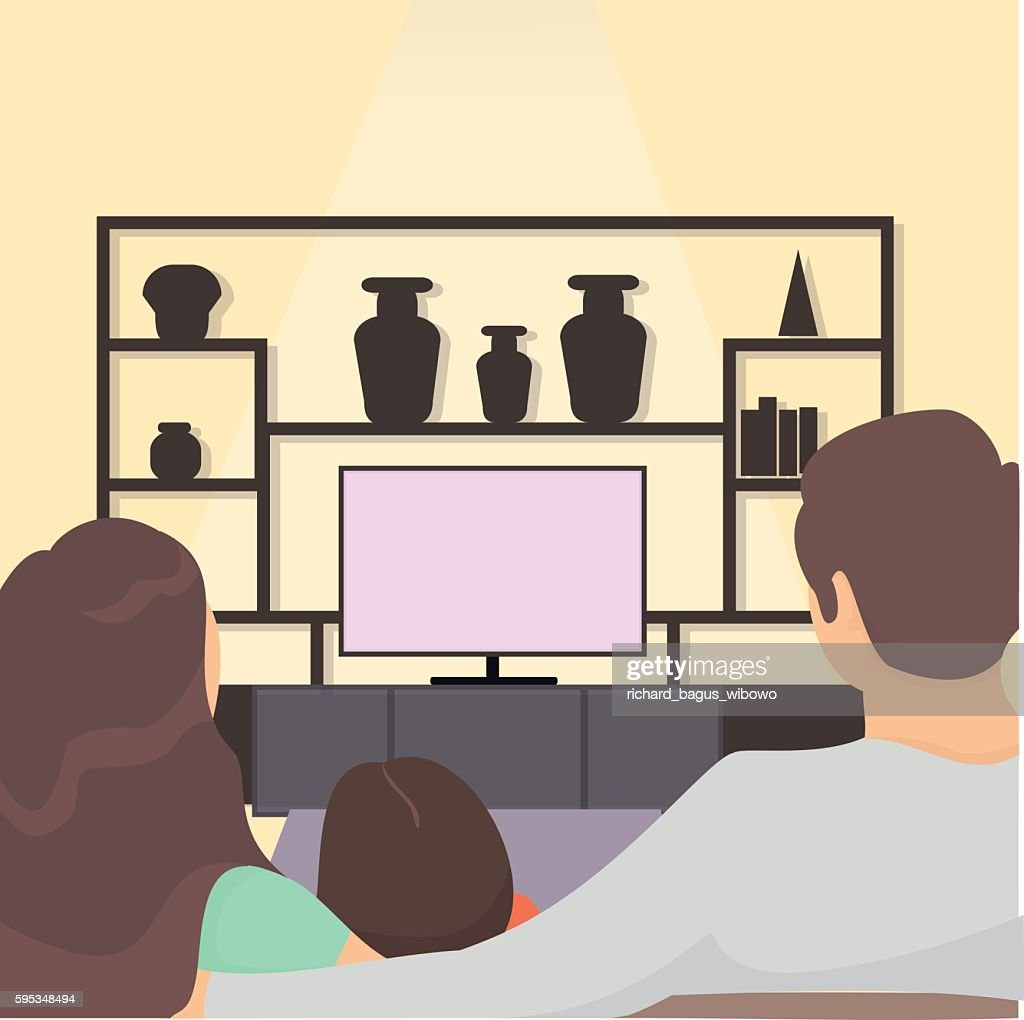 family watching tv together. family sitting on sofa watching television