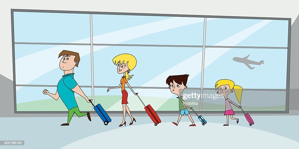 Family with suitcases at the airport