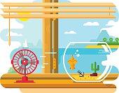 Fan and Aquarium on Windowsill Next to Open Window