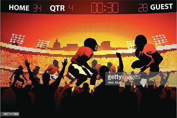 Fans watching football game on large screen