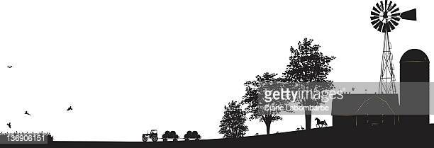 farm scene black silhouette with buildings,windmill, trees and tractor - tractor stock illustrations
