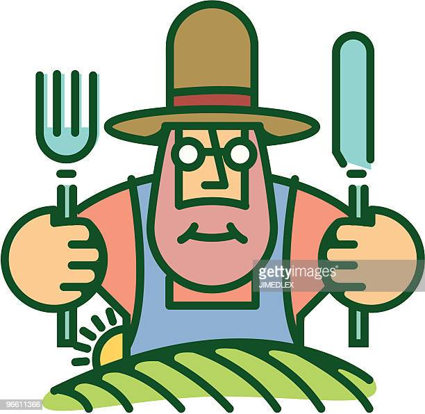Farmer eating from food he grows on land