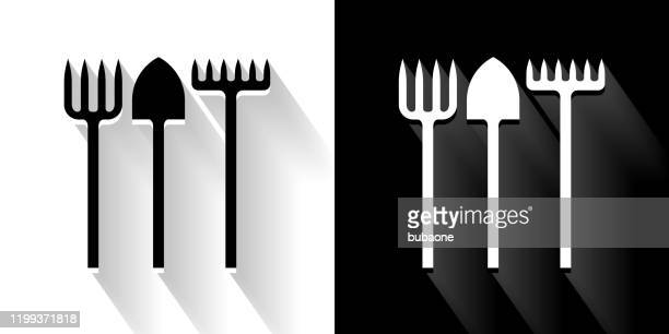 farming utensils black and white icon with long shadow - garden fork stock illustrations