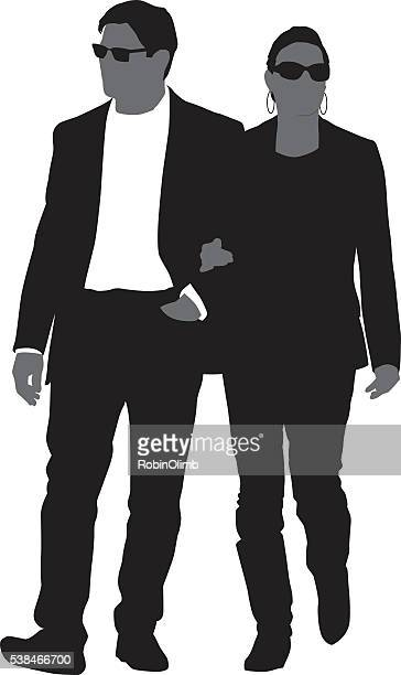 fashioanable couple walking together - arm in arm stock illustrations, clip art, cartoons, & icons