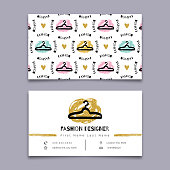Fashion designer business card, stylist, Modern hipster minimal design. Graphics marker hand drawn, Gold and black elements on a white background. Sketch clothes hanger seamless pattern. Vector