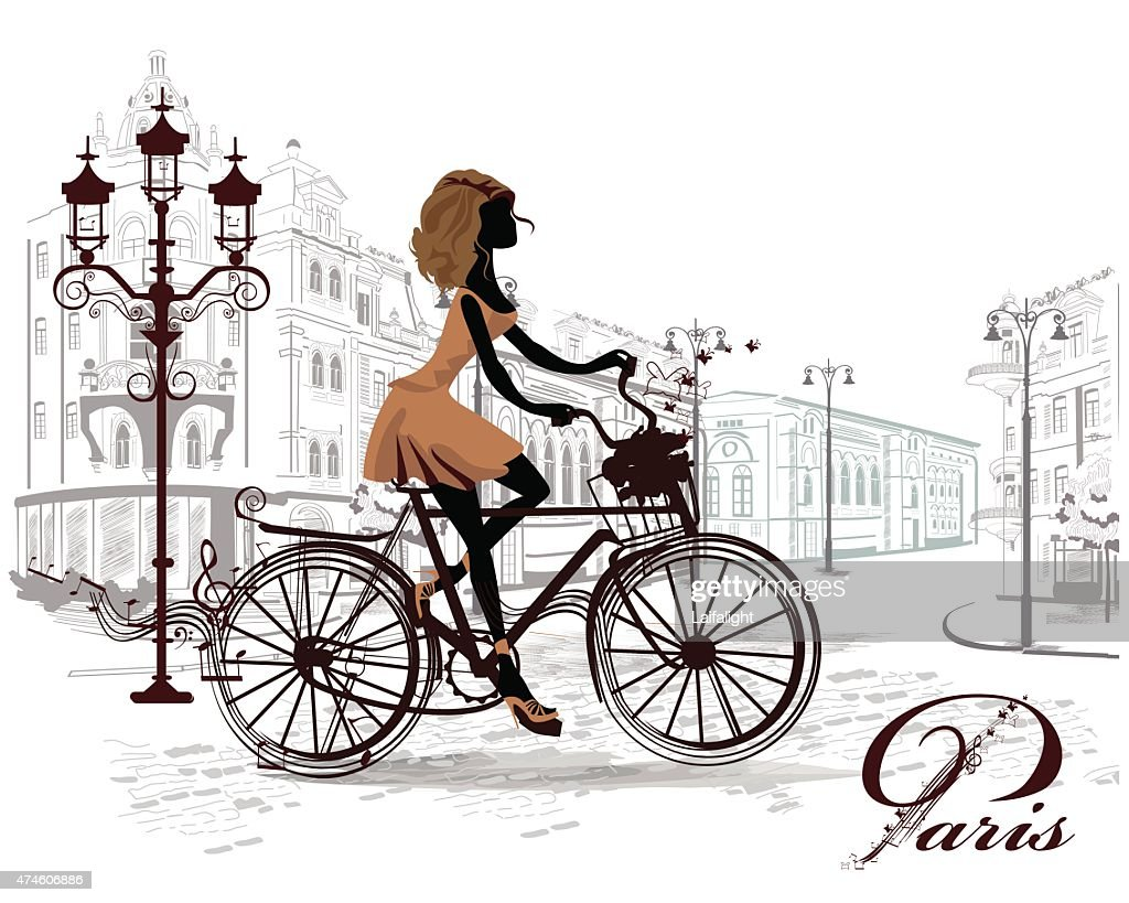 Fashion girl rides a bicycle