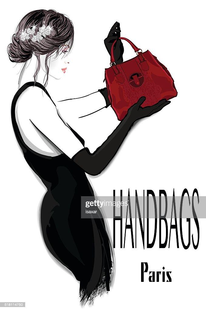 Fashion woman model in black dress with handbag