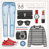 Fashion woman'€™s casual outfit with jeans, frock top, sneakers