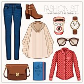 Fashion woman'€™s outfit with plaid shirt, jeans, cape and boots