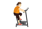 Fat woman doing cycling exercise with stationary bicycle.