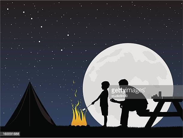 father and son camping around campfire - cracker snack stock illustrations, clip art, cartoons, & icons
