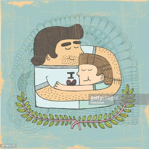 Vader en zoon omhelzing