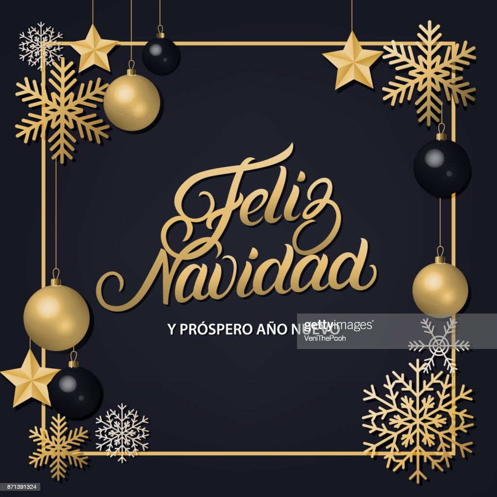 Feliz Navidad hand written lettering with golden decoration ornament.