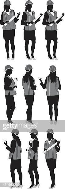 female architect in various poses - building contractor stock illustrations