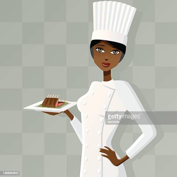 Weibliche Küchenchef mit Lammkoteletts