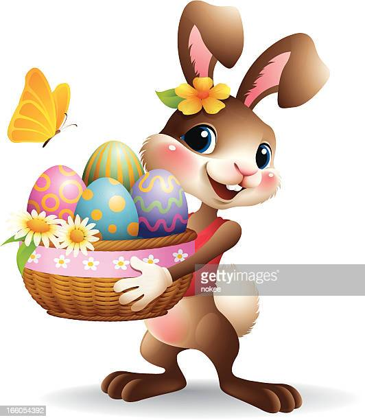 a female easter bunny holding a basket of eggs - easter bunny stock illustrations