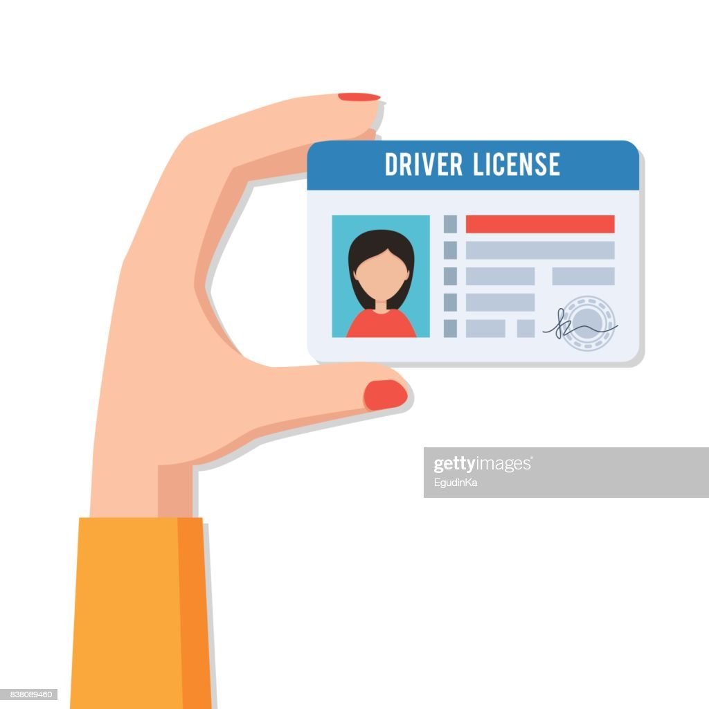 Female hand with driver license
