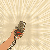 female hand with retro microphone