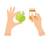 Female hands are holding apple and cure in a container.