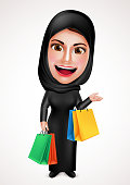Female muslim arab vector character holding shopping bags