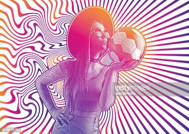 Female soccer fan kissing soccer ball