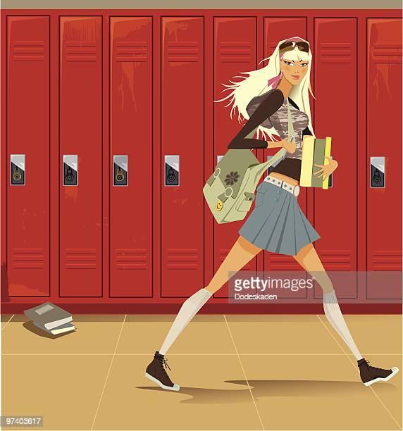 Female Student Walking Through Hallway with Lockers