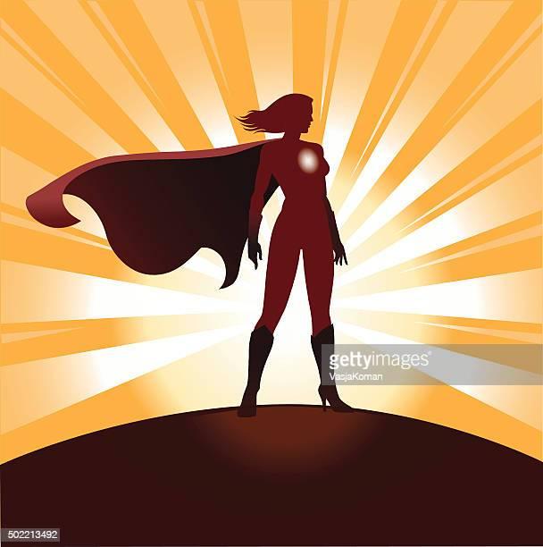 female superhero silhouette with sunrays - heroines stock illustrations
