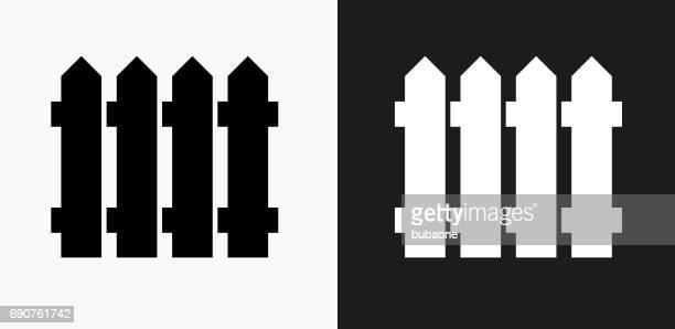 fence icon on black and white vector backgrounds - hurdle stock illustrations