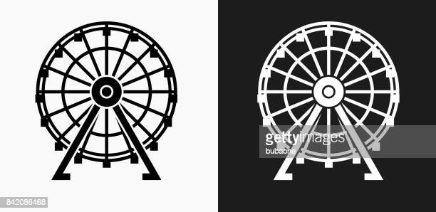 ferris wheel icon on black and white vector backgrounds - ferris wheel stock illustrations, clip art, cartoons, & icons